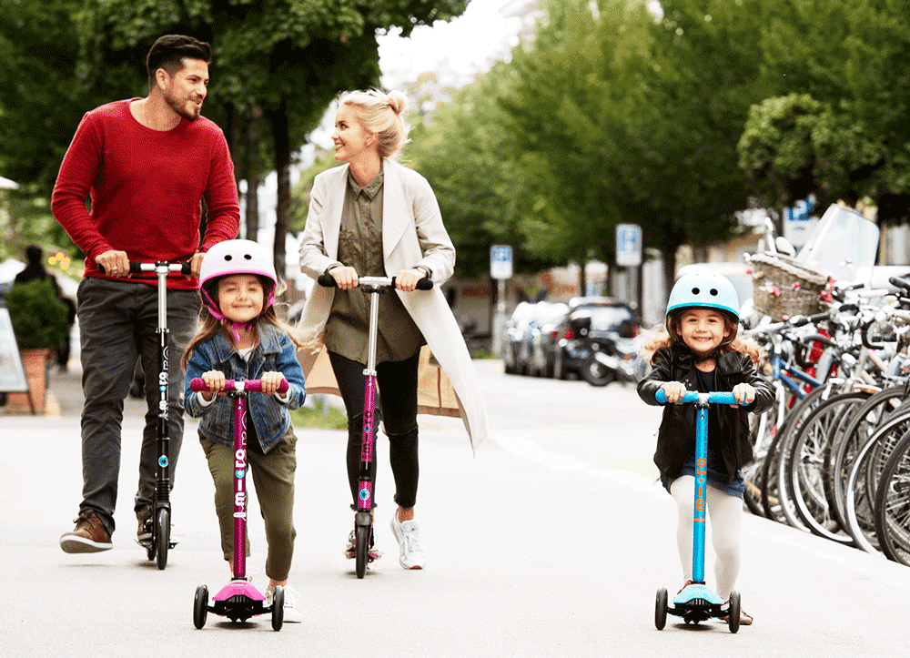 family riding kick scooters