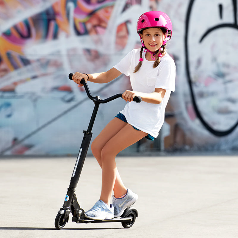 girl riding micro sprite deluxe black kick scooter