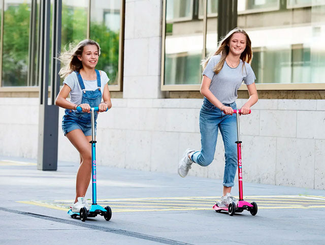 girls riding micro maxi deluxe three wheel kick scooter