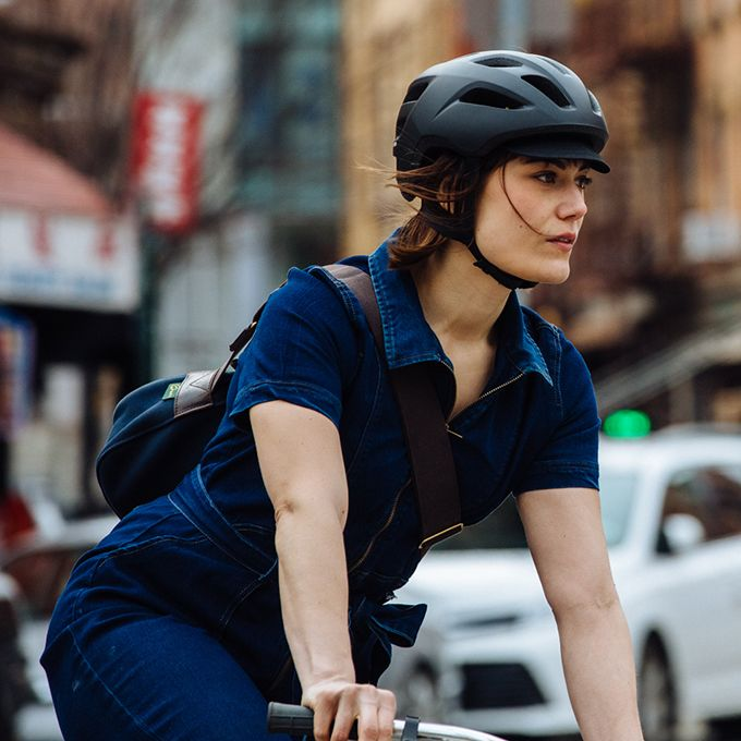 woman cyclist wearing Giro Cormick Helmet in the city