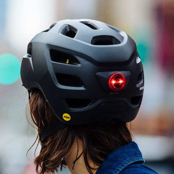 rear view of Giro Cormick helmet in matte black, showing rear red LED light