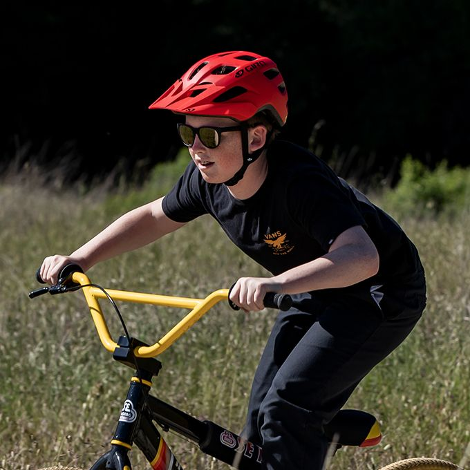 boy wearing giro tremor helmet riding bicycle
