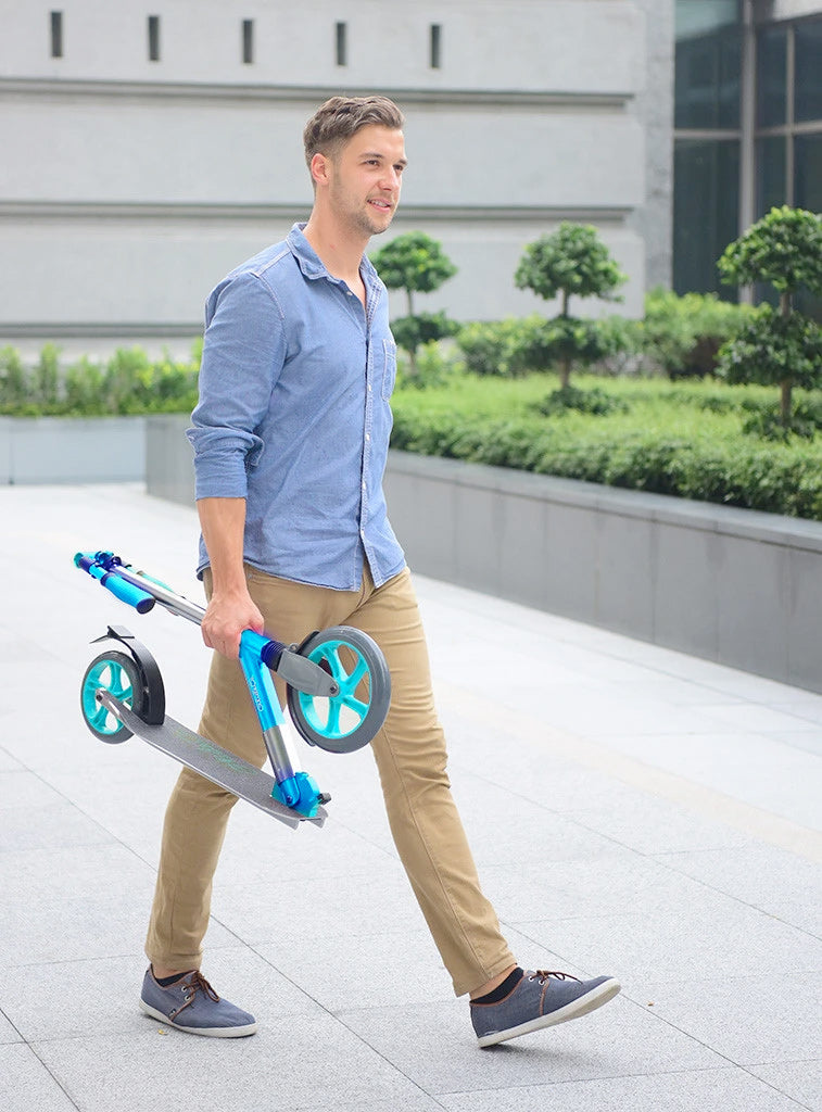 glideco cruiser 230 kick scooter turquoise being hand carried