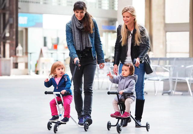 ladies using micro trike kids pram buggy