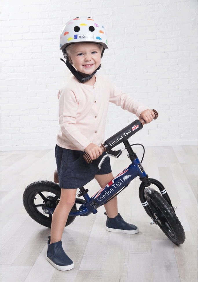 london taxi balance bike with girl white
