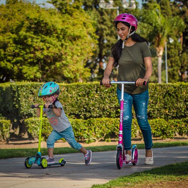 mother and child riding razor kick scooter
