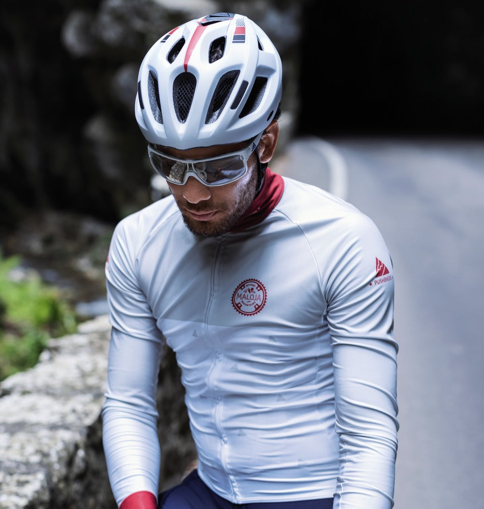 male cyclist wearing Abus Aduro bicycle helmet in silver