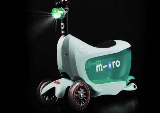 Micro Mini2go 3 wheel convertible kick scooter for kids in mint, showing light