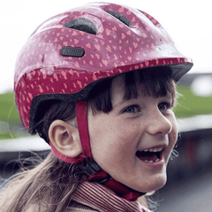 Young girl wearing Abus Smiley 2.0 bicycle helmet for children