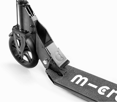 Micro Downtown Black kick scooter folding mechanism close up