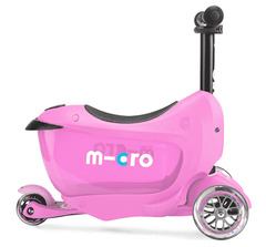 Micro Mini2go 3 wheel kick scooter with seat and push rod for kids in pink, side view