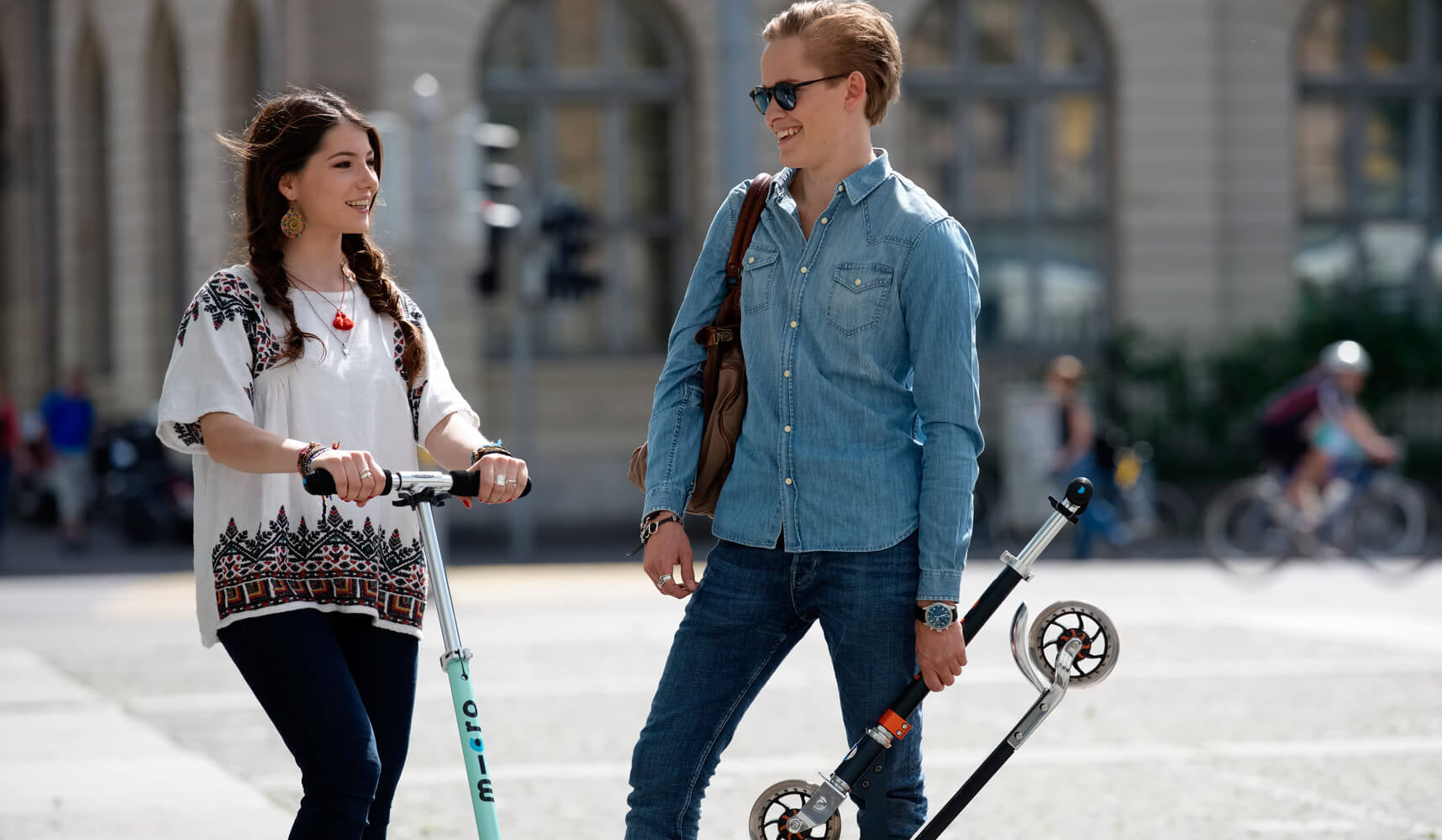 Couple with Micro Speed+ kick scooters