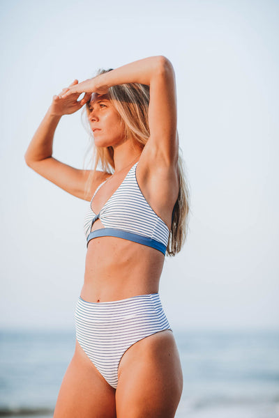 woman at beach wearing the Hanalei bikini top in ocean stripe - Summer Label Swimwear.  Best summer bikinis!