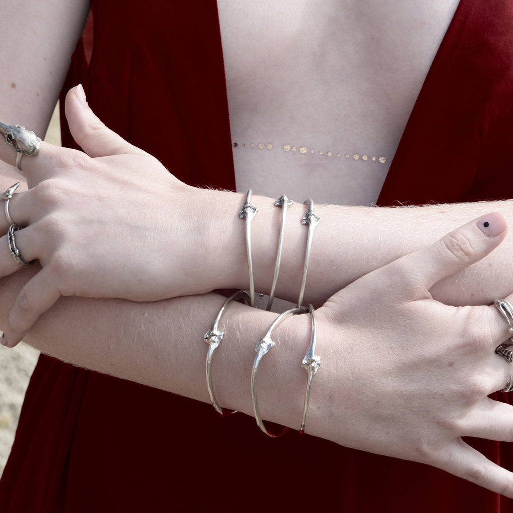 Wyvern Rib Bangles . Single and Trifecta .
