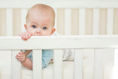 baby chewing on crib, crib rail cover safety tips
