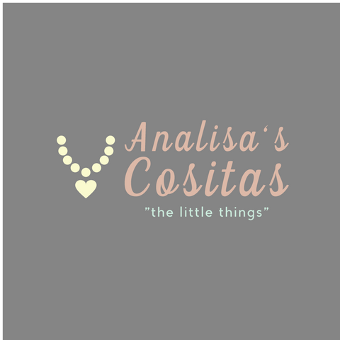 "analisas cositas logo ""Analisa's Cositas The Little Things"" Grey background, pink lettering, yellow tone beaded necklace with heart pendant"