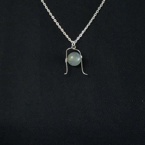 moss agate pendant necklace, silver tone cable chain necklace on a black covered bodice
