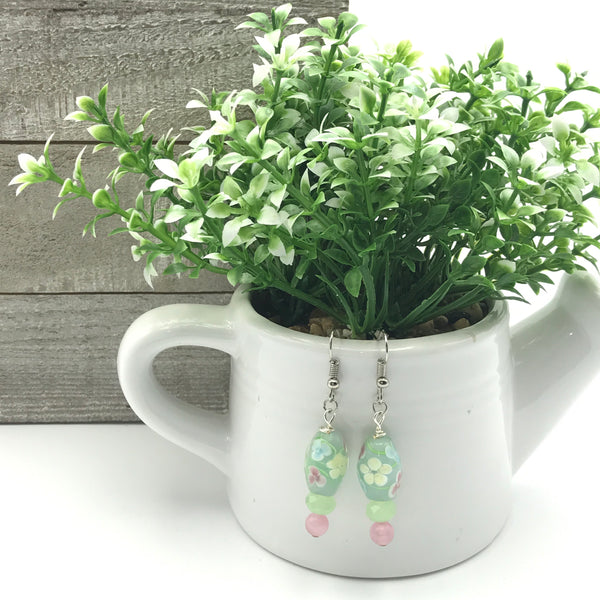 green ceramic beads, hand painted flowers, small green round beads, pink round beads, dangle earrings, fish hook ear wires
