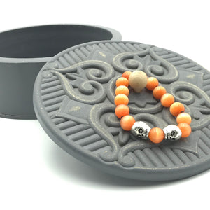 orange glass round beads, silver tone skull beads, stretch bracelet