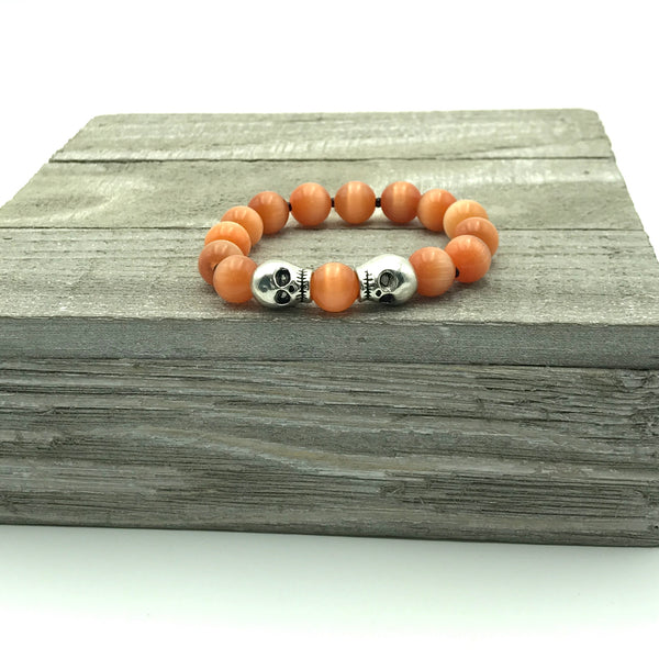 Orange Beaded Bracelet with Silver Skulls