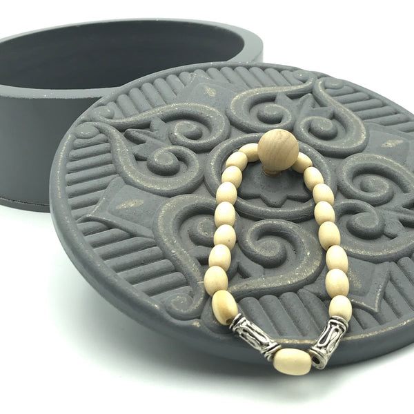 Cream Wood and Tribal Silver Tone Beaded Bracelet