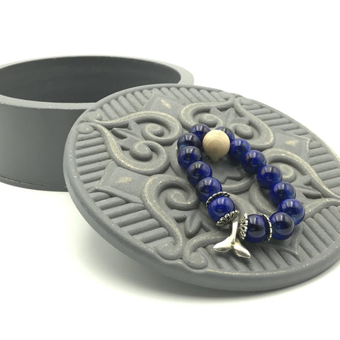 medium blue round glass beads, dolphin fin bead, stretch bracelet