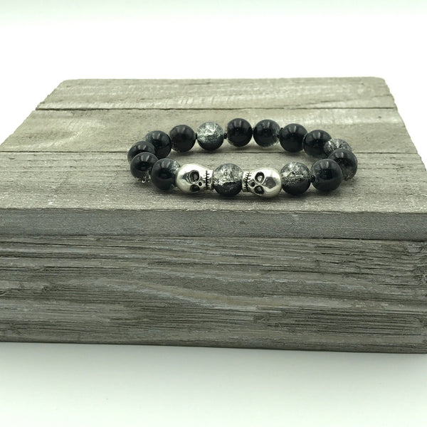 black glass round beads, silver tone skull charms beads, stretch bracelet