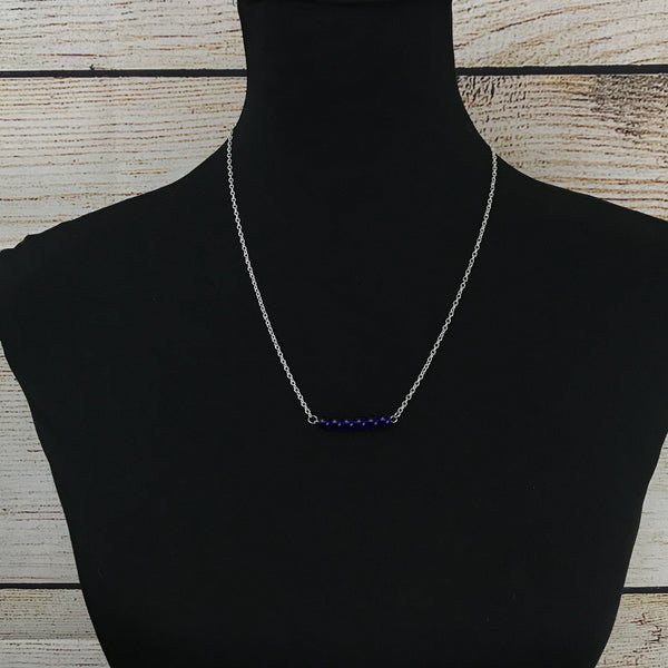 silver tone chain, beaded bar pendant, blue seed beads, single strand necklace