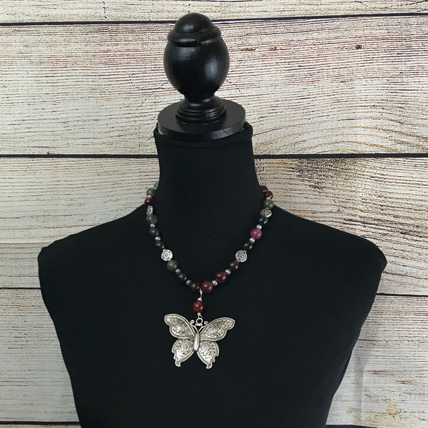 pink and green round agate beads, ornate silver spacers, large butterfly pendant, single strand necklace