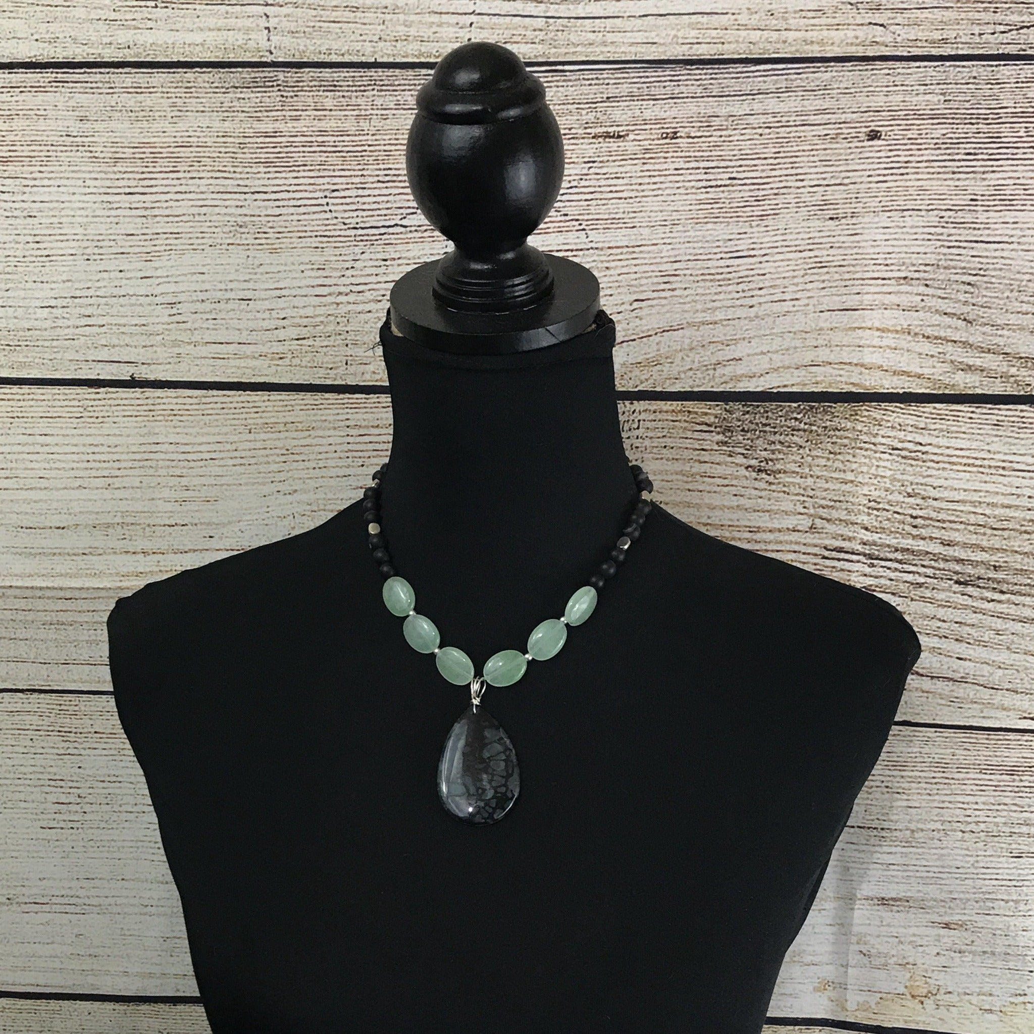 green round beads, black round beads, black faceted pendant with silver tone trim, double strand necklace