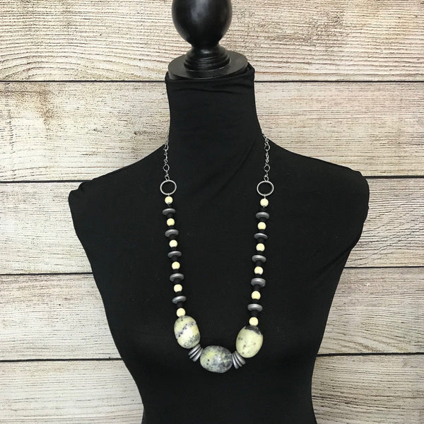 large yellow turquoise beads, yellow chalk round beads, grey wooden disc beads, black matte round beads, silver tone chain, single strand necklace