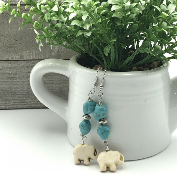 turquoise blue nugget beads, silver saucer spacer beads, white elephant beads, dangle earrings