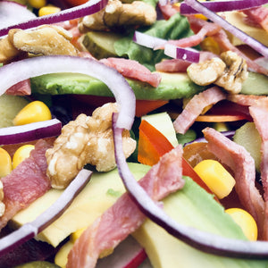 Bacon, avocado, walnut and red onion salad