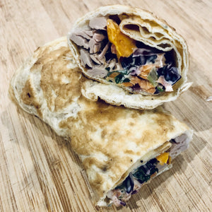 Pulled pork, roasted sweet potato and kaleslaw egg wrap