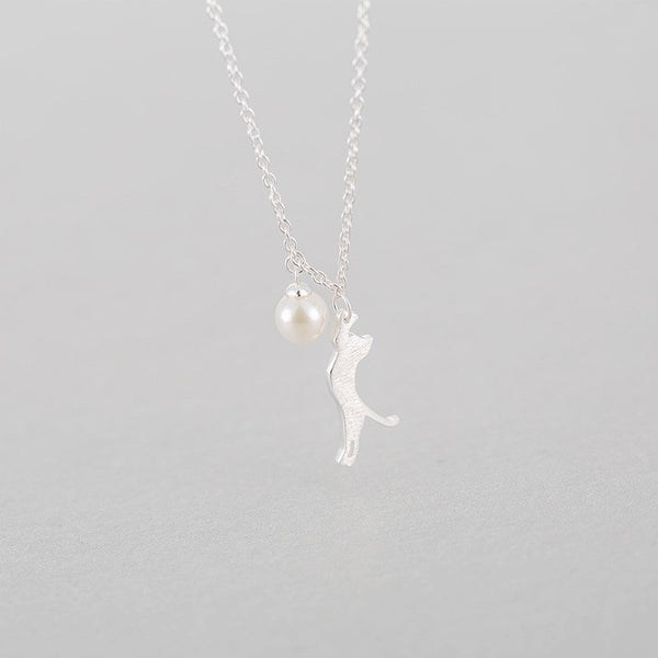 Kitty Dangling By A Pearl Necklace