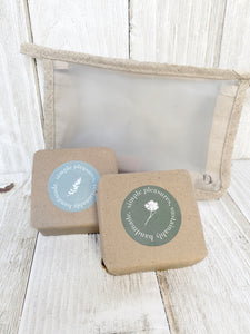 eucalyptus and lavender soap wrapped laying against our eco friendly essentials bag,