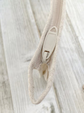 Load image into Gallery viewer, hemp zipper close up shot of the eco essentials bag