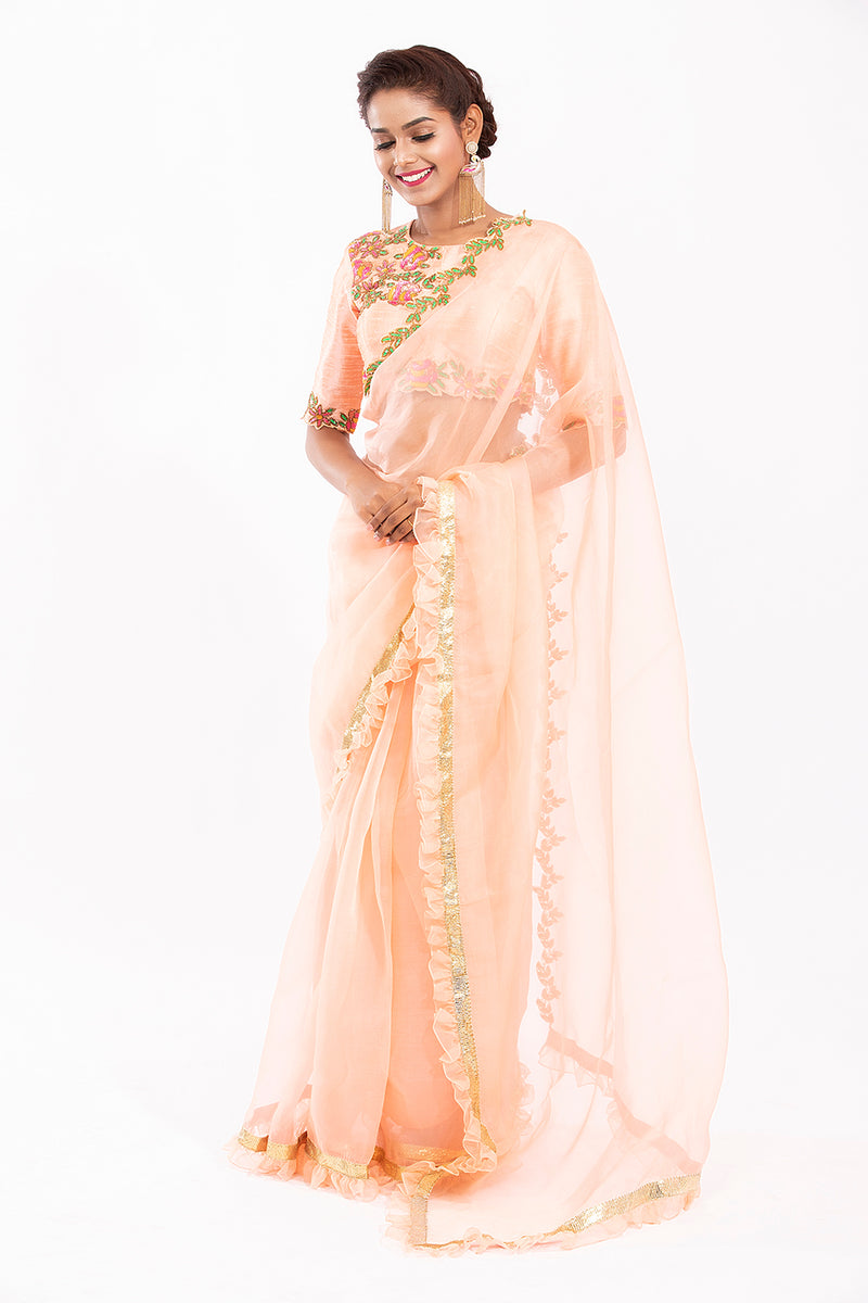 Peach ruffle embroidered saree