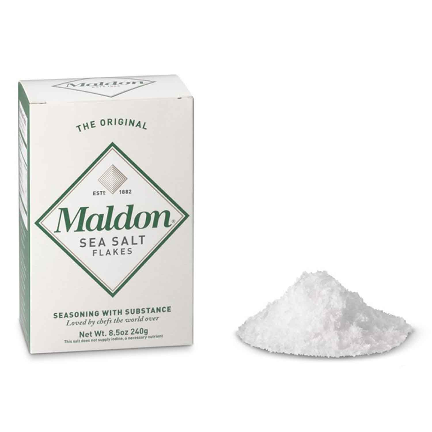 8.5oz box of Maldon Sea Salt Flakes next to a small pile of salt flakes