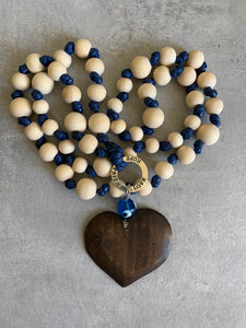 Prayer bead with wood beads and blue knots