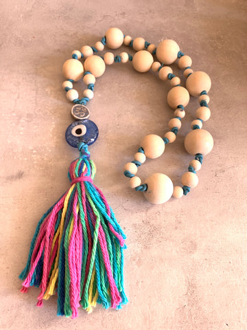Om ceramic bead with evil eye and wood worry beads
