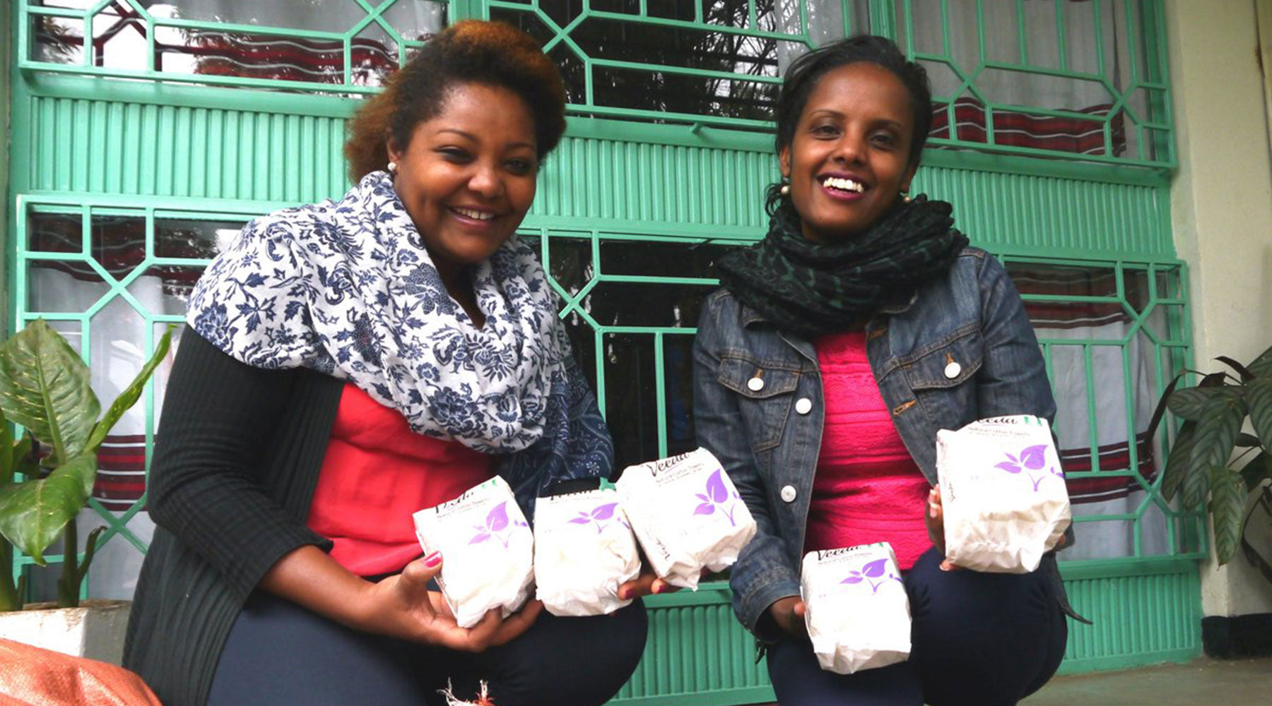 Two women holding Veeda pads