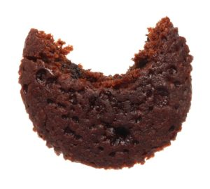 Image of a small cake with a curved bite taken out of it
