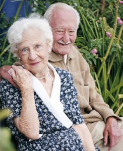 Two elderly people sitting together