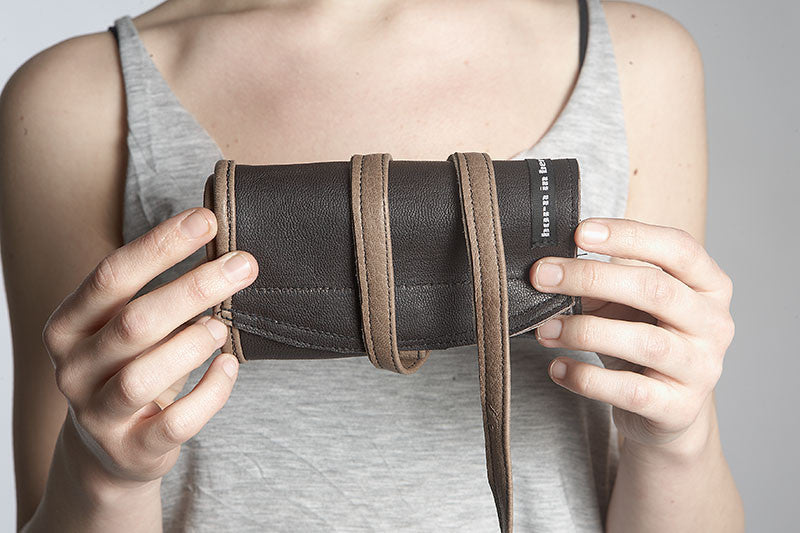 rolled up purse with straps
