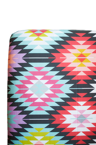 fitted crib sheet in pink kilim