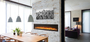 Make a statement with the Napoleon Entice™ 72 Electric Fireplace. This fireplace puts out an incredible amount of heat, glittering with multicolored flames and a crystal ember bed. You don't need a specialist or a gas fitter for this expansive beauty, just hang on the wall and plug in for instant transformation of your space. Traditional orange flames, or cool blue flames, or a combination of the two will set the mood.