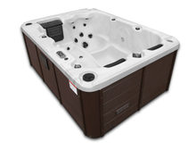 Load image into Gallery viewer, The Canadian Spa Company Montreal Plug & Play spa fits in almost any location. This roomy but compact spa is packed with all the features of a full-sized spa and easily accommodates 3 adults. It features 29 adjustable stainless steel hydrotherapy jets and one lounger for maximum relaxation among couples, friends, and family. Energy-efficient and easy to install – just plug it into an outlet and start relaxing right away! The Montreal uses 50 sq ft of filtration along with a built-in ozone generator to keep