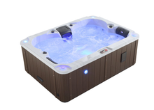 Load image into Gallery viewer, The Canadian Spa Company Kelowna SE Plug and Play is the perfect addition to any backyard! The Kelowna SE features multi-colour LED mood lighting with two cascading water falls to create a soothing and relaxing atmosphere. Set the mood with the MP3 Bluetooth audio for the perfect ambiance. An aromatherapy canister is built into the design to allow for scented beads to ease your tensions and melt away stress. This Plug & Play hot tub can be located wherever there is access to a standard 120V 15A circuit for