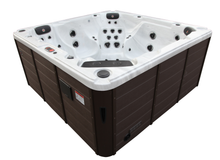 Load image into Gallery viewer, Alberta SE 57 Jet 6 Person Hot Tub. Description:Enjoy the benefits of true luxury in the comfort of your own home. The Alberta SE Hot Tub is packed with high-end features such as Bluetooth Audio, LED mood lighting, cascading and fountain waterfalls, as well as aromatherapy. It is equipped with two 5 horsepower (16.4A), 2 speed pumps that accommodate 4 different speed control configurations.